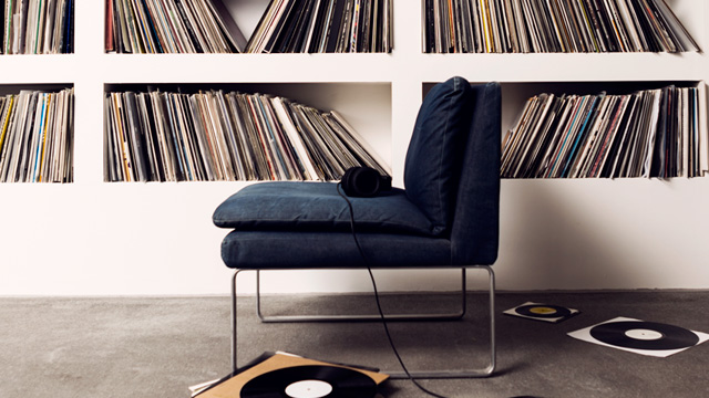 Blue sofa in front of record collection