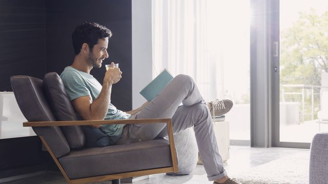 Man drinking tea and reading book - big