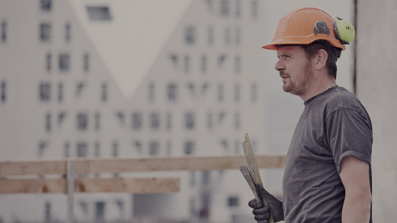 Construction worker at building site large