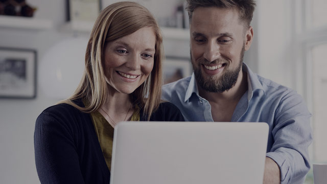 young couple looking at laptop 2 small overlay