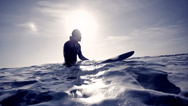 Surfer in ocean - Small