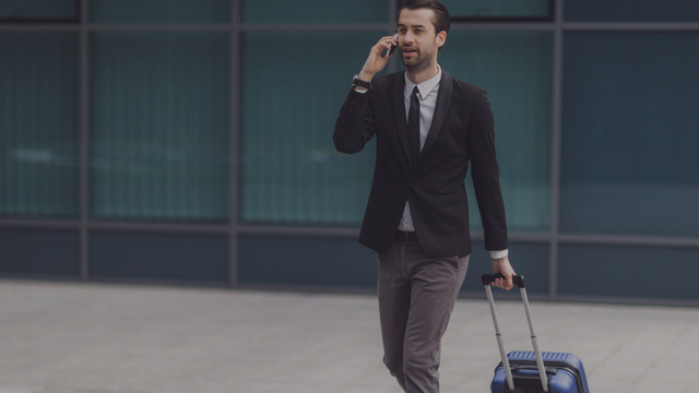 Business man with suitcase small