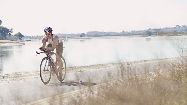 Triathlete man bicycling small image